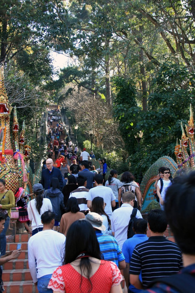 Doi Suthep...just a few kilometers outside is sheer madness...yes, it's a holy place, but it's a profitable racket too....Hurry up and line up!!!